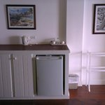 The counter top and fridge