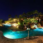 Pool & Lava Rock Water Feature at night