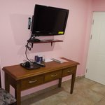 Flat screen TV and dresser in standard room