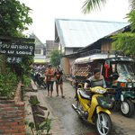  In front of the guest house, heading to morning market