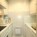  Small kitchen with washing machine and more