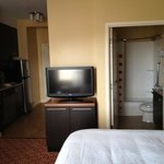 Clean small room, TV side of bed, includes kitchenette