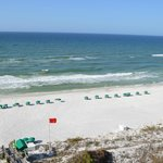  view of beach chairs/umbrellas from balcony