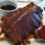Ribs atop very limp fries.