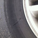  a pic of the slashed tire to my car that I had parked in the space in front of my room