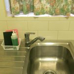 Kitchen sink, dishwashing liquid also provided