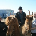 Riding Icelandic horses in front of Guesthouse with locals