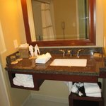 nice roomy marble or granite countertop in bathroom