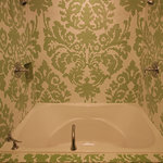 Mosaic Tile around the 85-gallon two-person soaking tub in Maria's Curtains Big King Theme Room