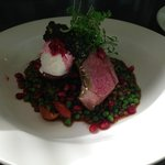 Roasted lamb with puy lentils, pomegranate, goats curd & piccada