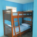 Room with 2 Queen beds and a set of bunk beds