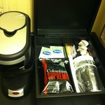  Coffee maker with coffee and tea in the room