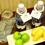 Complimentary bottled water and fruits