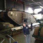 Owen in front of the Tank his Dad helped to restore as an apprentice