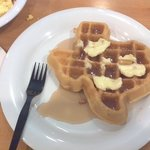 Continental breakfast.  Waffles shaped like Texas.  Cute !!