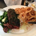 Hangar steak with steamed spinach, whipped potatoes and fried onions