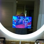  Cool in-mirror remote-controlled bathroom TV