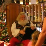  Santa talking to a little girl who visited his workshop