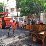 road work in progress in front of adams wood house