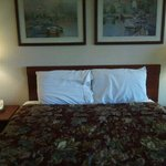 our queen size bed, decent linens and very flat pillows