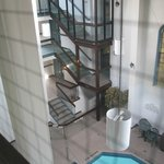 Open hallway and staircases to pool atrium