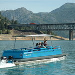 Explore the Lake by patio boat. Ski boat and fishing boats also available for rent.