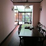 SHARED DINING ROOM LOOKING ONTO PATIO