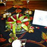 Fruit, wine, candles and a card