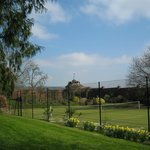 Astroturf tennis court in walled garden