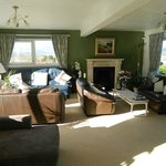 Lovely large parlour with fireplace and views