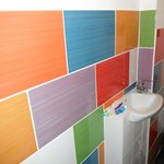 Nice tiles - best bit! And eyebath sink handy for toilet.