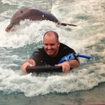"Enjoying the ""foot push"" across the lagoon provided by the dolphin Isis."