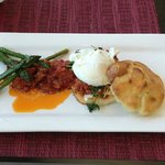 Gourmet Breakfast: Poached egg, buttermilk biscuit, burrata, Italian sausage ragu, roasted aspar