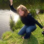  Happy guest catching trout in our lake