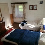 Second room with twin beds and extra blankets