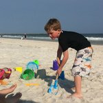  Making a sand castle down at the beach!