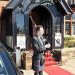  Piper outside the Piersland House Hotel awaiting bride &amp; groom