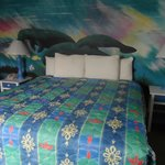 Great mantee mural on wall behind the king bed