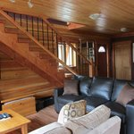  Bear Lodge living area, flat screen TV and leather sofa bed
