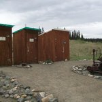 The spotlessly-clean outhouses