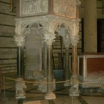 The elaborately carved pulpit in the Baptistery