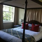  the four poster bed in our suite room 163
