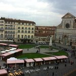 view from the breakfast room--- weekend market on Piazza SMN.
