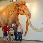 All of us in front of the life size painting of a Pleistocene Mammoth