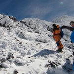 Lahouceine leading the group on the upper slopes of Mount Toubkal
