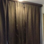 dirty curtains at room entrance