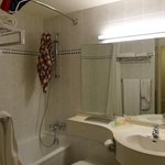clean, but smallish bathroom with older decor