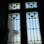 One of the original stained glass windows located in the stairway from the lobby.