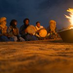  Singing and drumming around the camp fire
