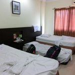  View of room with extra bed